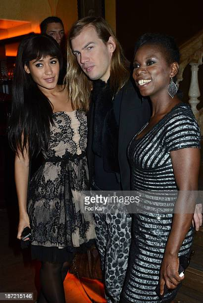 Josephine Jobert Christophe Guillarme and ice skater champion Surya Bonaly attend the 'Bistro Chic Napoleone' Champs Elysees Opening Cocktail on...