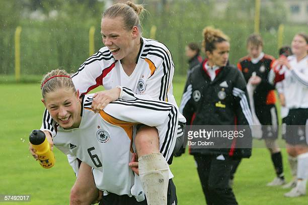Josephine Schlanke and Isabel Kerschowski of Germany celebrate their qualification after the Women's Under 19 European Championship qualifying match...