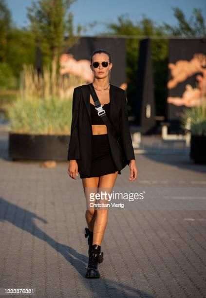 Josephine Skriver is seen wearing cropped top, black, bag boots outside Rotate on August 12, 2021 in Copenhagen, Denmark.