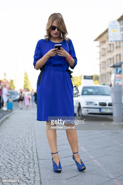 Josephine Thiel is seen attending RIANI wearing blue dress and heels during the Berlin Fashion Week July 2018 on July 4 2018 in Berlin Germany