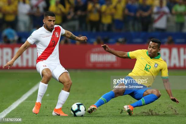 Josepmir Ballon of Peru fights for the ball with Alex Sandro of Brazil during the Copa America Brazil 2019 group A match between Peru and Brazil at...