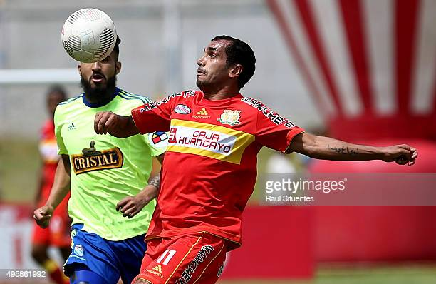 Josepmir Ballon of Sporting Cristal battless for the ball with Blas Lopez of Sport Huancayo during a match between Sport Huancayo and Sporting...