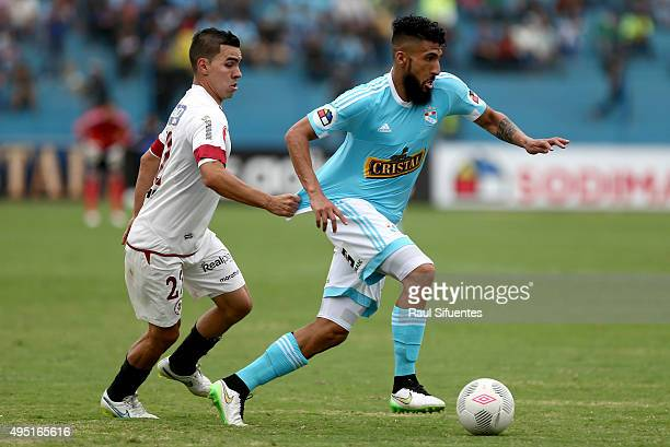 Josepmir Ballon of Sporting Cristal is challenged by Enrique Salcedo of Leon de Huanuco during a match between Sporting Cristal and Leon de Huanuco...