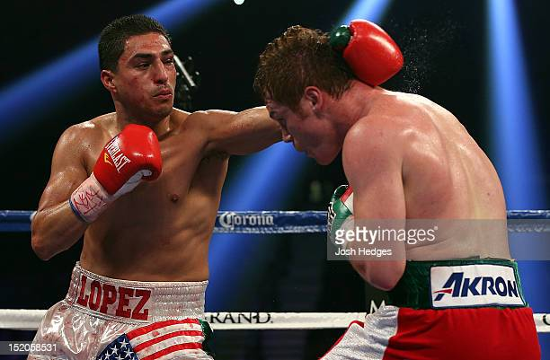 Josesito Lopez lands a left to the head of Canelo Alvarez during their WBC super welterweight title fight at MGM Grand Garden Arena on September 15...
