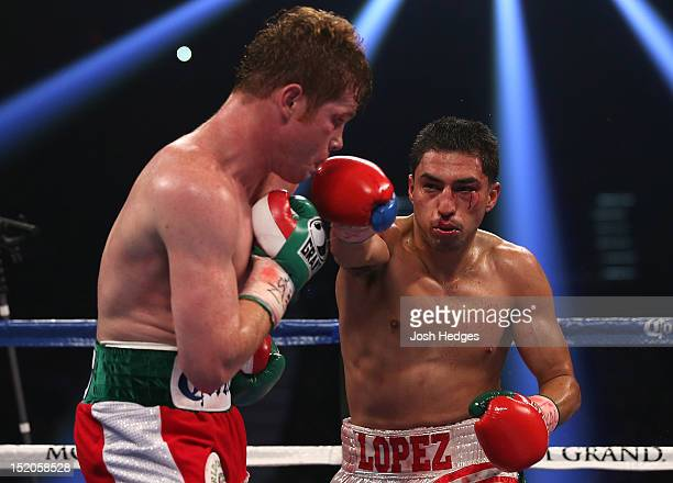 Josesito Lopez lands a right to the head of Canelo Alvarez during their WBC super welterweight title fight at MGM Grand Garden Arena on September 15...
