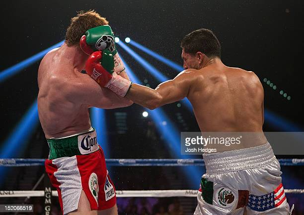 Josesito Lopez throws a left against Canelo Alvarez during their WBC super welterweight title fight at MGM Grand Garden Arena on September 15 2012 in...