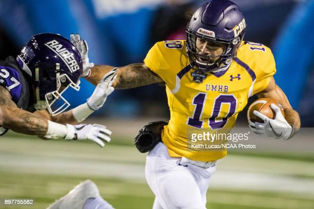 J Josey of the University of Mary HardinBaylor stiff arms Masai McDaniel of the University of Mount Union during the Division III Men's Football...