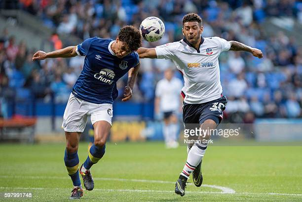 Josey Yarney of Everton and Kaiyne Woolery of Bolton Wanderers in action during the Checkatrade Trophy group match between Bolton Wanderers and...
