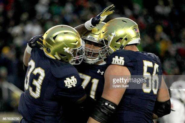 Josh Adams Alex Bars and Quenton Nelson of the Notre Dame Fighting Irish celebrate after scoring a touchdown in the third quarter against the North...