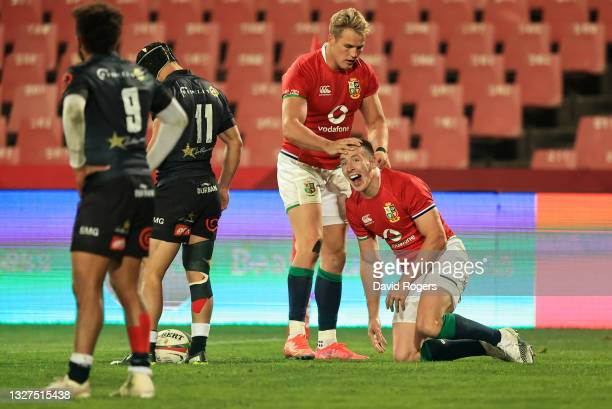 Josh Adams of The British and Irish Lions celebrates with teammate Duhan van der Merwe after scoring their side's fifth try during the Cell C Sharks...