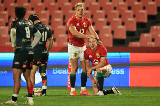 JOHANNESBURG, SOUTH AFRICA - JULY 07: Josh Adams (R) of The British and Irish Lions celebrates with teammate Duhan van der Merwe after scoring their side's fifth try during the Cell C Sharks v British & Irish Lions tour match at Emirates Airline Park on July 07, 2021 in Johannesburg, South Africa. (Photo by David Rogers/Getty Images)