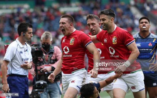 Josh Adams of the Lions celebrates scoring his side's first try during the 1888 Cup match between the British & Irish Lions and Japan at BT...