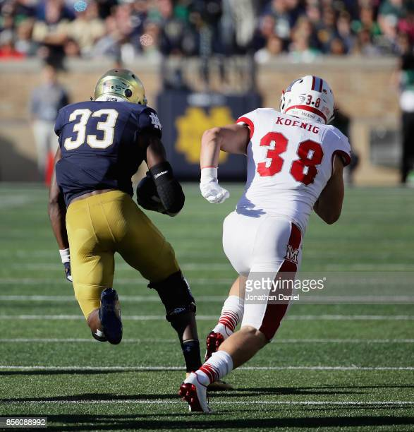 Josh Adams of the Notre Dame Fighting Irish breaks past Brad Koenig of the Miami Redhawks on a 72 yard touchdown run at Notre Dame Stadium on...