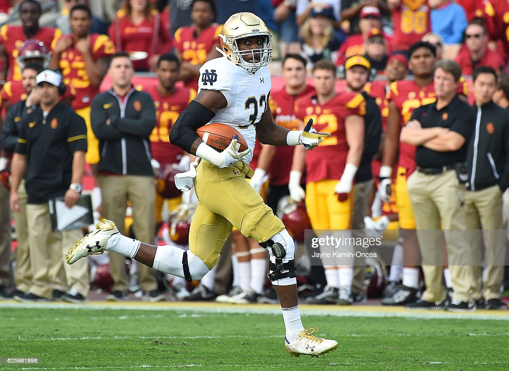 Josh Adams #33 of the Notre Dame Fighting Irish runs down field to the one yard line in the first quarter of the game against the USC Trojans at the Los Angeles Memorial Coliseum on November 26, 2016 in Los Angeles, California.