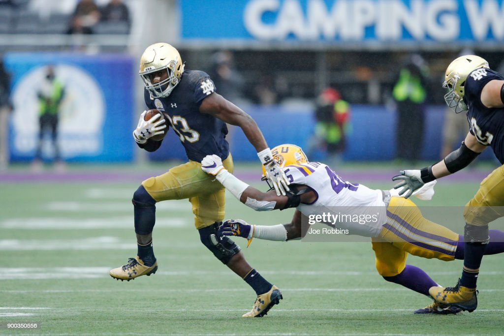 Josh Adams #33 of the Notre Dame Fighting Irish runs the ball in the third quarter of the Citrus Bowl against the LSU Tigers on January 1, 2018 in Orlando, Florida. Notre Dame won 21-17.