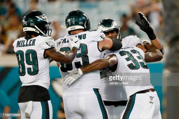 Josh Adams of the Philadelphia Eagles is congratulated by Braxton Miller and teammates after scoring a touchdown during the second half against the...
