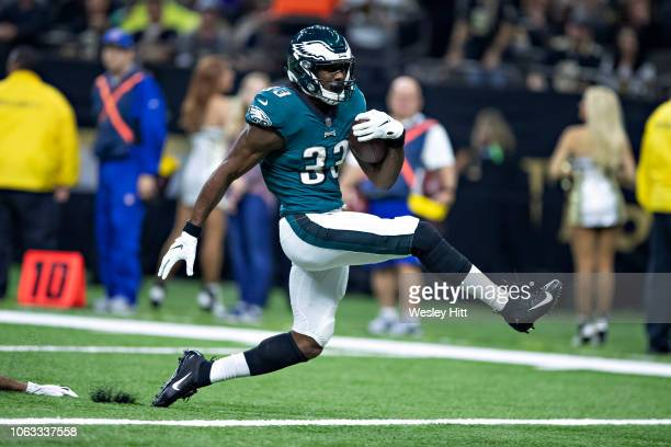Josh Adams of the Philadelphia Eagles runs the ball in for a touchdown in the first half of a game against the New Orleans Saints at MercedesBenz...