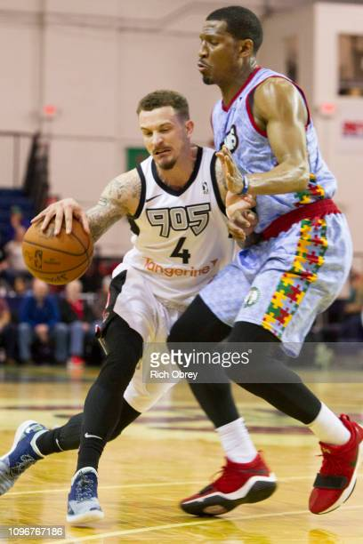 Josh Adams of the Raptors 905 bounces off Andrew White of the Maine Red Claws on Saturday February 9 2019 at the Portland Expo in Portland Maine NOTE...