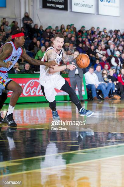 Josh Adams of the Raptors 905 dribbles around Archie Goodwin of the Maine Red Claws on Saturday February 9 2019 at the Portland Expo in Portland...