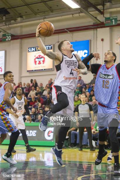 Josh Adams of the Raptors 905 goes up for a shot against John Bohannon of the Maine Red Claws on Saturday February 9 2019 at the Portland Expo in...