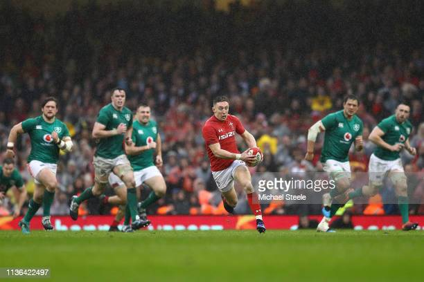 Josh Adams of Wales breaks clear of the Ireland defence during the Guinness Six Nations match between Wales and Ireland at Principality Stadium on...