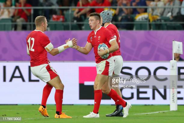 Josh Adams of Wales celebrates scoring his team's first try with Hadleigh Parkes of Wales during the Rugby World Cup 2019 Group D game between Wales...