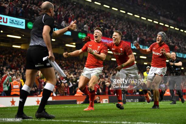 Josh Adams of Wales celebrates with Liam Williams and Jonathan Davies as he scores their second Wales try during the Guinness Six Nations match...