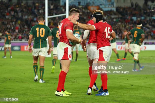 Josh Adams of Wales celebrates with teammate Leigh Halfpenny after scoring his team's first try during the Rugby World Cup 2019 Semi-Final match...