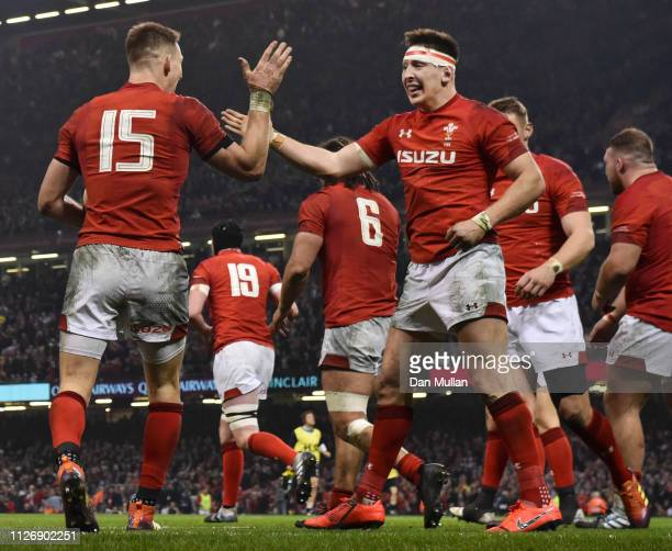 Josh Adams of Wales celerbates scoring his sides second try with teammate Liam Williams during the Guinness Six Nations match between Wales and...