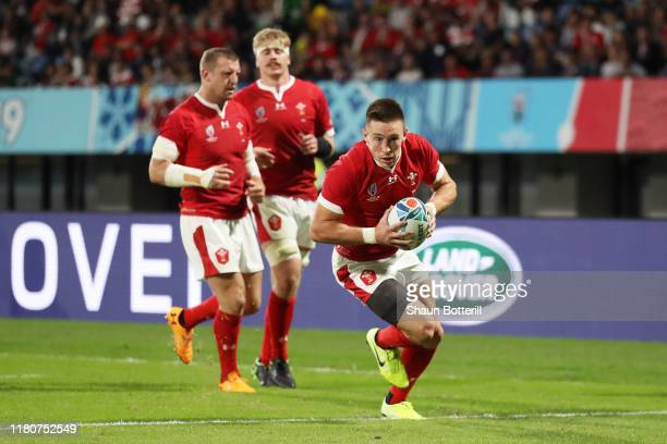 Josh Adams of Wales crosses to score his team's second try during the Rugby World Cup 2019 Group D game between Wales and Uruguay at Kumamoto Stadium...