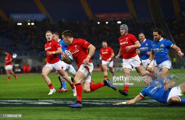 Josh Adams of Wales crosses to score their first try during the Guinness Six Nations match between Italy and Wales at Stadio Olimpico on February 09...