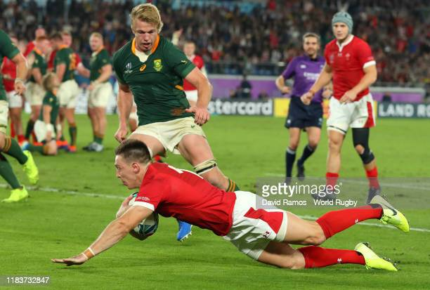 Josh Adams of Wales goes over to score his team's first try during the Rugby World Cup 2019 SemiFinal match between Wales and South Africa at...