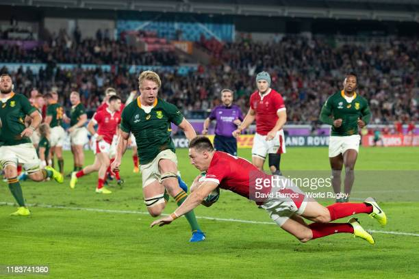 Josh Adams of Wales goes over to score his team's first try during the Rugby World Cup 2019 Semi-Final match between Wales and South Africa at...