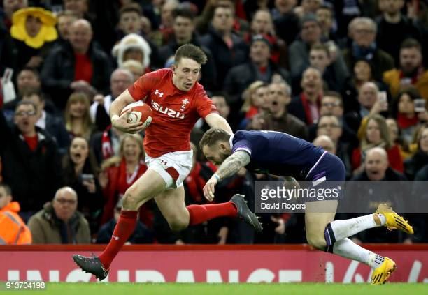 Josh Adams of Wales holds off Byron McGuigan of Scotland during the Natwest Six Nations round One match between Wales and Scotland at Principality...