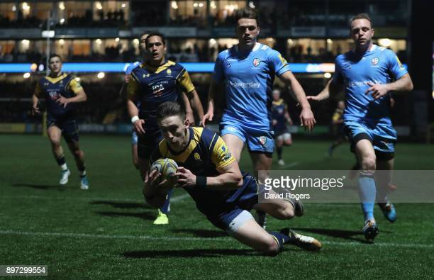 Josh Adams of Worcester Warriors dives over to score the first try during the Aviva Premiership match between Worcester Warriors and London Irish at...