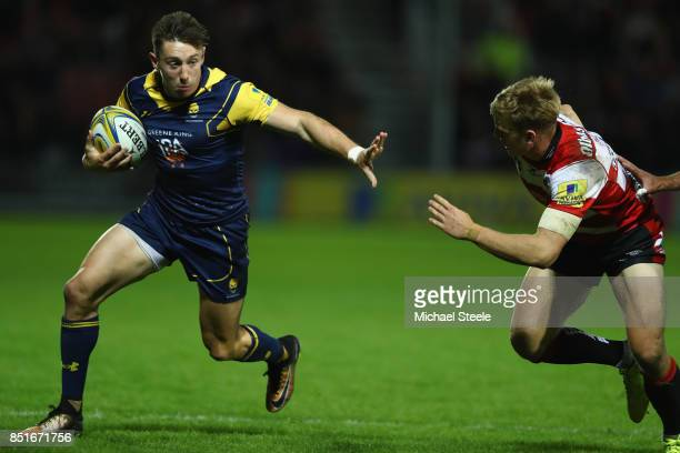 Josh Adams of Worcester Warriors holds off Ollie Thorley of Gloucester during the Aviva Premiership match between Gloucester Rugby and Worcester...