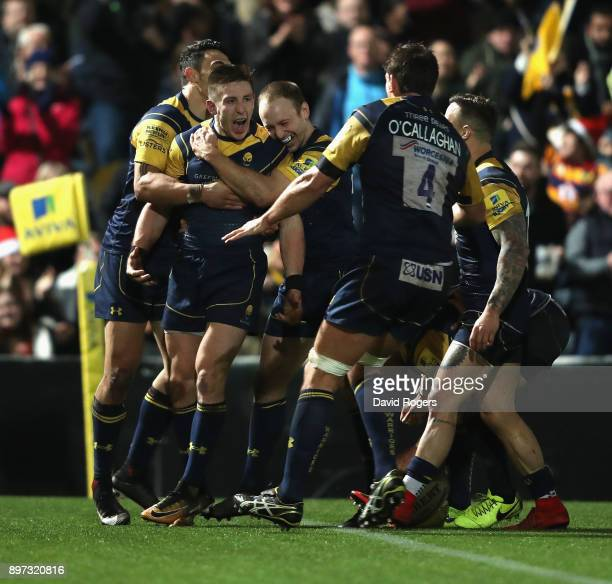 Josh Adams of Worcester Warriors is mobbed by team mates after scoring his second try during the Aviva Premiership match between Worcester Warriors...