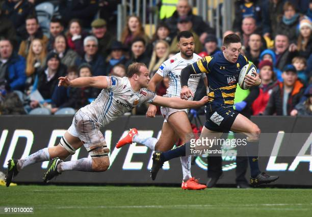 Josh Adams of Worcester Warriors is tackled by Tom Lawday of Exeter Chiefs during the AngloWelsh Cup match between Worcester Warriors and Exeter...