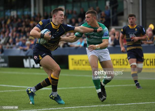 Josh Adams of Worcester Warriors sees off the challenge of Adam Radwan of Newcastle Falcons during the Gallagher Premiership Rugby match between...