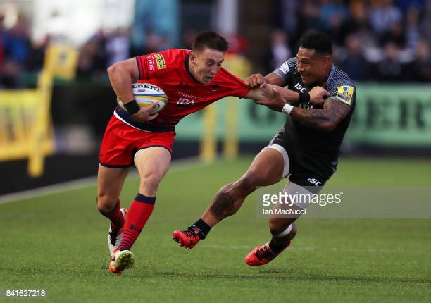 Josh Adams of Worcester Warriors vies with Sonatane Takulua of Newcastle Falcons during the Aviva Premiership match between Newcastle Falcons and...