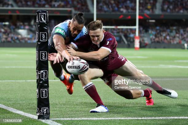 Josh Add-Carr of the Blues attempts to score a try during game one of the 2020 State of Origin series between the Queensland Maroons and the New...