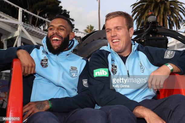 Josh AddoCarr and Jake Trbojevic of the Blues enjoy the rides at Luna Park while posing for portrait during a New South Wales Blues State of Origin...
