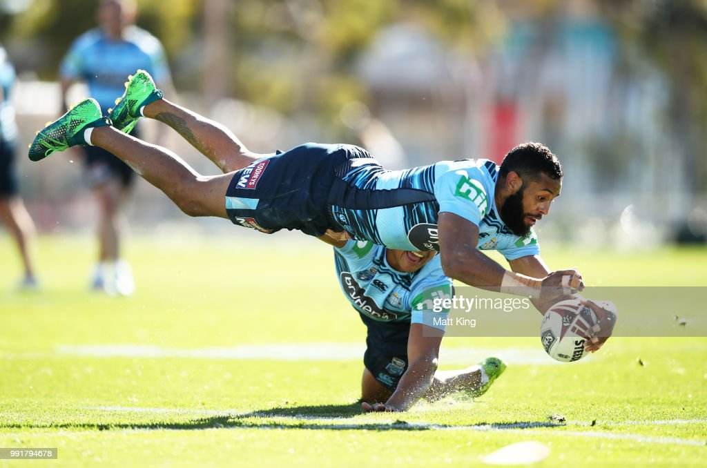 Josh Addo-Carr dives in front of Latrell Mitchell during a New South Wales Blues State of Origin training session at NSWRL Centre of Excellence Field on July 5, 2018 in Sydney, Australia.