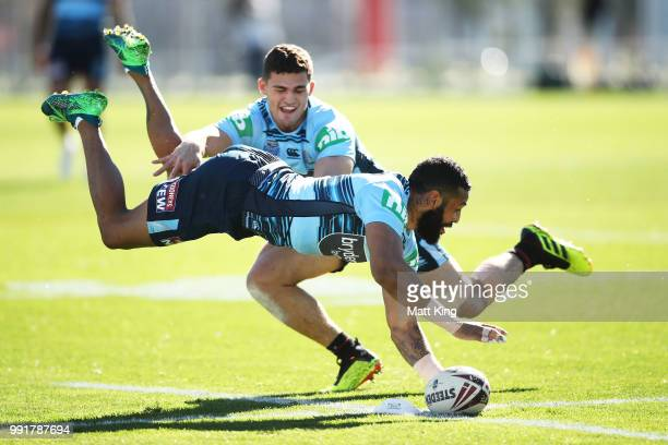 Josh AddoCarr dives in front of Nathan Cleary during a New South Wales Blues State of Origin training session at NSWRL Centre of Excellence Field on...