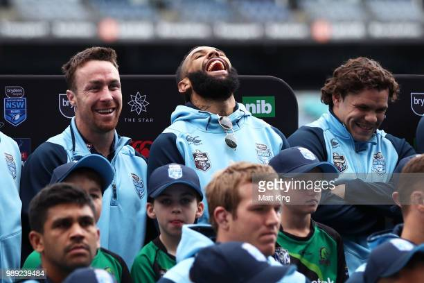 Josh AddoCarr laughs alongside James Maloney and James Roberts during the New South Wales Blues State of Origin Team Announcement at ANZ Stadium on...