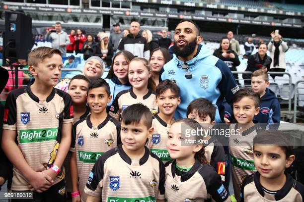 Josh AddoCarr meets young participents during the New South Wales Blues State of Origin Team Announcement at ANZ Stadium on July 2 2018 in Sydney...