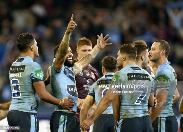 Josh AddoCarr of the Blues celebrates a win with teammates during game one of the State Of Origin series between the Queensland Maroons and the New...