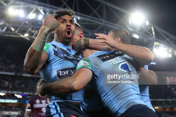 Josh Addo-Carr of the Blues celebrates after a try scored by James Tedesco of the Blues during game three of the 2019 State of Origin series between...