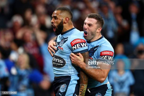 Josh Addo-Carr of the Blues celebrates after scoring a try with James Tedesco of the Blues during game two of the 2021 State of Origin series between...