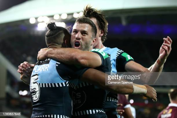 Josh Addo-Carr of the Blues celebrates with James Tedesco of the Blues after scoring a try during game one of the 2020 State of Origin series between...